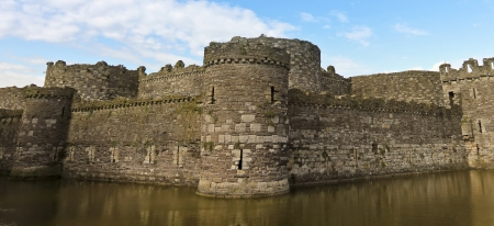 Beaumaris, Wales - July 18: Beaumaris Castle on July 18, 2012, in Anglesey, Wales. The moat at Beaumaris Castle, a popular tourist destination. Редакционное