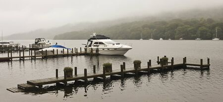 cumbria: A Boat Dock on a Misty Lake in Cumbria, England