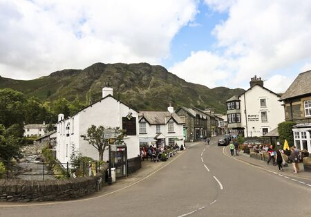 cumbria: Coniston, England - July 27: Yewdale Road on July 27, 2012, in Coniston, Cumbria, England. Coniston is very popular with tourists for hill-walking and rock-climbing.