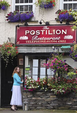 cumbria: Bowness-on-Windermere, England - July 24: The Postilion Restaurant on July 24, 2012, on Ash Street in Bowness-on-Windermere, England. This popular restaurant tends toward spicy mediterranean. Editorial
