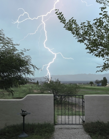 A Lightning Bolt Strikes Outside the Front Courtyard Gate photo