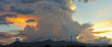 unsettled: An Unsettled Sky Above the Huachuca Mountains at Sunset in Arizona Stock Photo