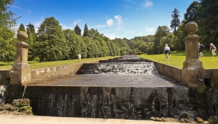 chatsworth: Derbyshire, Great Britain - July 5: Chatsworth House Cascade on July 5, 2012, in Derbyshire, Great Britain. Chatsworth House is one of Britains most stately homes and biggest tourist draws. Editorial