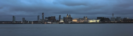 mersey: Liverpool glitters at night, from across the Mersey River. Liverpool landmarks The Royal Liver Building, Museum of Liverpool, Merseyside, Cunard Building and Port of Liverpool Building can be seen. Editorial