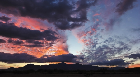 sunsets: A Gorgeous Sunset of Red and Blue Over a Mountain Horizon