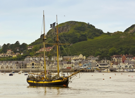 topsail: Conwy, Wales - July 17: Conwy River on July 17, 2012, in Conwy, Wales. The River Conwy harbors a replica of the famous HMS Pickle with Deganwy, Wales, in the background.