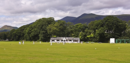 cumbria: Keswick, Cumbria - July 25: Fitz Park Cricket Ground on July 25, 2012, in Keswick, Cumbria, England, voted Loveliest Cricket Ground in England by Wisden Cricket Monthly in 2001.