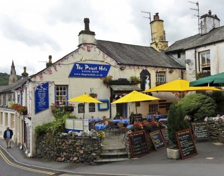 Ambleside, England - July 27: The Priest Hole on July 27, 2012, in Ambleside, England. The Priest Hole Restaurant and Tea Rooms - great food in the heart of the Lake District. Stock Photo - 16093718