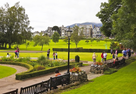 cumbria: Keswick, Cumbria - July 25: Crow Park on July 25, 2012, in Keswick, Cumbria, England. Crow Park, on the banks of Derwent Water, is popular with locals, tourists and golfers.