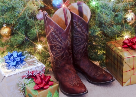 A Pair of Red Christmas Cowboy Boots and Presents Under the Tree