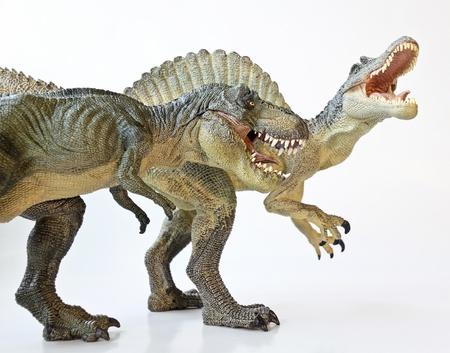A Spinosaurus Dinosaur in a Face Off with a Tyrannosaurus Rex Archivio Fotografico