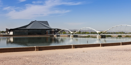 publicly: Tempe, Arizona - June 12: The Tempe Center for the Arts on June 12, 2013, in Tempe, Arizona. A great blue heron stands on a Tempe Town Lake wall across from the Tempe Center for the Arts, a publicly owned performing and visual arts center in Tempe, Arizon