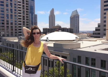 A Woman on a Rooftop Overlooking Downtown San Diego Stock Photo
