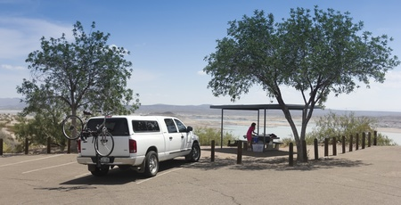 ELEPHANT BUTTE, NEW MEXICO, JULY 10 - Elephant Butte Lake State Park on July 10, 2013, near Elephant Butte, New Mexico. A woman tourist prepares a picnic lunch at Elephant Butte Lake State Park, New Mexico, one of the most popular destinations in the stat