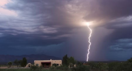 glows: A Bolt of Lightning Strikes in the Mountain Foothills