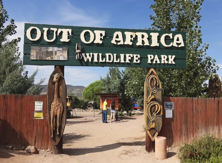 CAMP VERDE, ARIZONA - JULY 27: The Out of Africa Wildlife Park on July 27, 2013, near Camp Verde Arizona. A young couple reads the Admissions placard at the entrance to the Out of Africa Wildlife Park near Camp Verde, Arizona, a very popular tourist attra