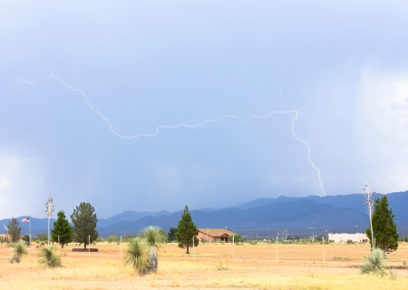 A Bolt of Lightning Strikes Horizontally Above a Rural Arizona Neighborhood