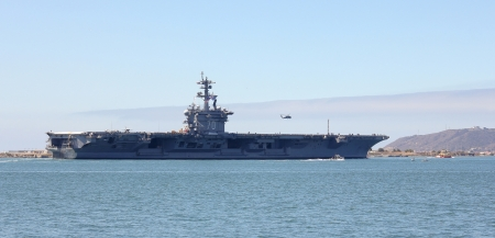 laden: SAN DIEGO, CALIFORNIA - JUNE 25: The USS Carl Vinson (CVN-70) on June 25, 2013, in San Diego Bay, California. The USS Carl Vinson (CVN-70) supercarrier being escorted out of San Diego Bay. The body of Osama bin Laden was disposed of in 2011 from its deck.