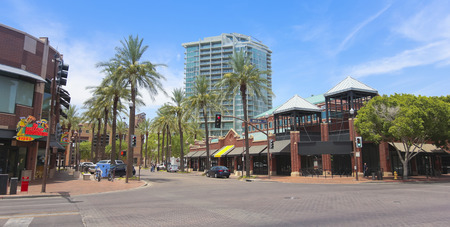 TEMPE, ARIZONA - JUNE 12: Mill Avenue on June 12, 2013, in Tempe, Arizona. Mill Avenue is an historic street in Tempe, Arizona, now a popular pedestrian-friendly shopping and nightlife district. Stock Photo - 23919497