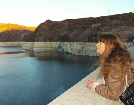river county: Clark County, Nevada - December 29: Hoover Dam on December 29, 2013, in Clark County, Nevada. A woman watches the sunset over Lake Mead from Hoover Dam, or Boulder Dam, in the Black Canyon of the Colorado River on the Arizona - Nevada border. Editorial