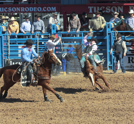 kyle: Tucson, Arizona - February 15: The La Fiesta De Los Vaqueros Rodeo on February 15, 2014, in Tucson, Arizona. Bareback rider Kyle Bowers aboard bronco Suzie Q in the 2014 Tucson Rodeo.