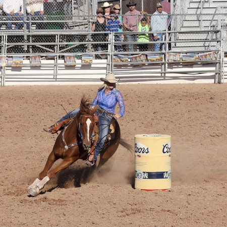 Tucson, Arizona - February 15: The La Fiesta De Los Vaqueros Rodeo on February 15, 2014, in Tucson, Arizona. Womens Barrel Racing in the 2014 Tucson Rodeo.