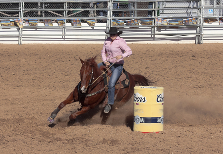 Tucson, Arizona - February 15: The La Fiesta De Los Vaqueros Rodeo on February 15, 2014, in Tucson, Arizona. Womens Barrel Racing rider Whitney Robinson in the 2014 Tucson Rodeo.