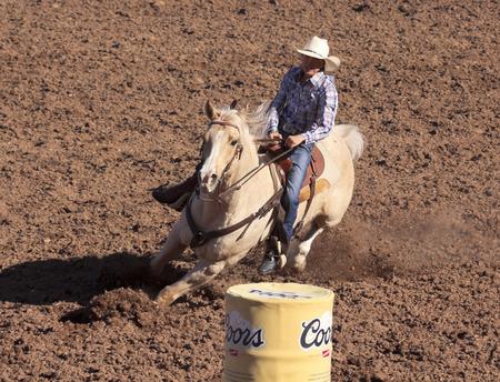 Tucson, Arizona - February 15: The La Fiesta De Los Vaqueros Rodeo on February 15, 2014, in Tucson, Arizona. Womens Barrel Racing rider Jill Welsh in the 2014 Tucson Rodeo.