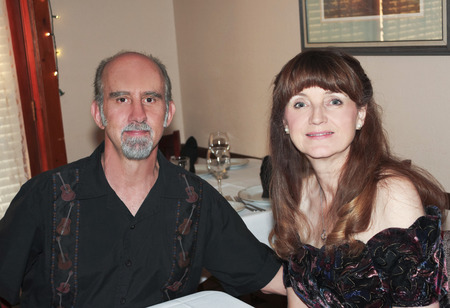 old man beard: A Middle Age Married Couple at a Dinner Restaurant Stock Photo
