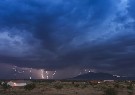 monsoon clouds: A Dance of Lightning Strikes in the San Jose Mountains Stock Photo