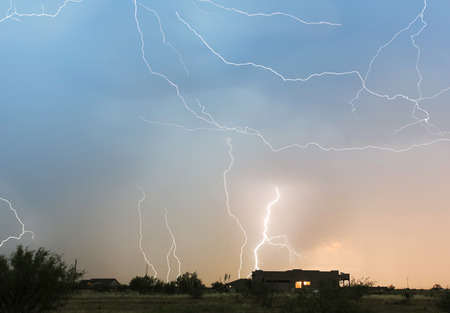 discharge: A Dance of Lightning Bolts Streak Wildly Above a Rural Neighborhood