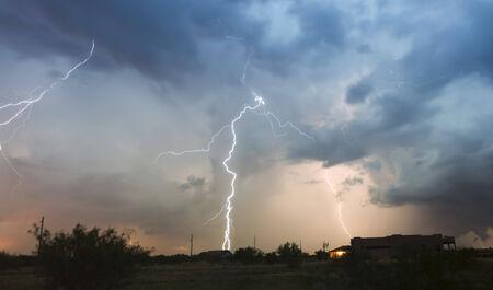 streak lightning: A Dance of Lightning Bolts Streak Wildly Above a Rural Neighborhood