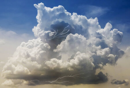 A Building Cumulonimbus Thundercloud with Lightning Strikes Within It