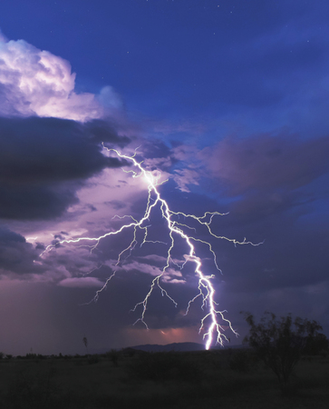 monsoon clouds: A Bolt of Lightning Strikes in a Stormy Desert Night