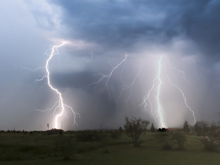 A Dance of Lightning Strikes Over a Rural Neighborhood at Night Foto de archivo
