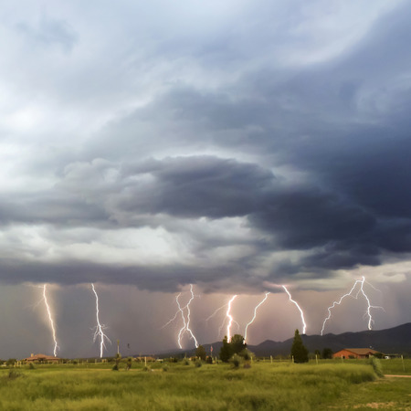 monsoon clouds: A Dance of Lightning Strikes in the Mule Mountain Foothills of Arizona