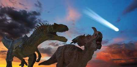 Allosaurus and Styracosaurus Battle as the Comet that Spells Extinction Approaches   Stock Photo