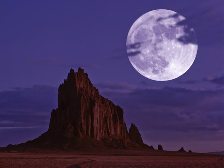 A Moonlit Shiprock, New Mexico, Rises From the Desert Plain Just After Moonrise photo