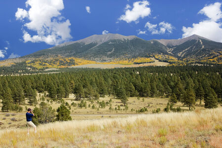 mount humphreys: A Man Photographs the Spectacular San Francisco Peaks Panorama in Fall