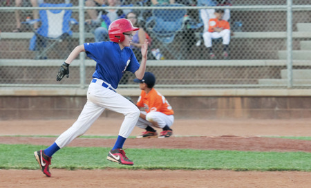attempts: Las Vegas, Nevada - October 18: A Summerlin park on October 18, 2014, in Las Vegas, Nevada. A runner attempts a stolen base in a youth baseball game in a Summerlin park in Las Vegas, Nevada.