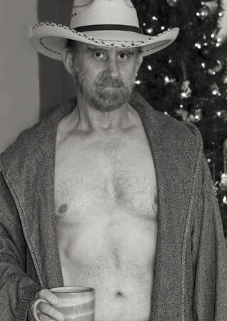 bare chested: A Cowboy with a Gray Beard in an Open Robe in Front of a Christmas Tree