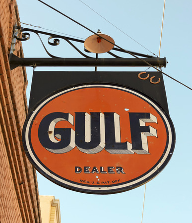 historical periods: Bisbee, Arizona - January 3: The historic Lowell district on January 3, 2015, in Bisbee, Arizona. A street scene of a vintage Gulf Oil sign in historic Lowell, Arizona.