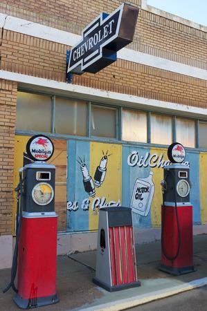 refurbished: Bisbee, Arizona - January 3: The historic Lowell district on January 3, 2015, in Bisbee, Arizona. A street scene of refurbished Mobil gas pumps and vintage signs in historic Lowell, Arizona.