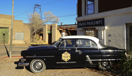 refurbished: Bisbee, Arizona - January 3: The historic Lowell district on January 3, 2015, in Bisbee, Arizona. A refurbished 50s Ford police car in historic Lowell, Arizona.