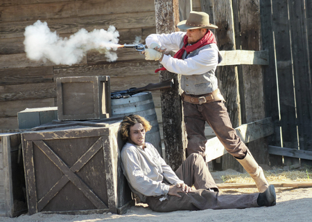 45 pistol: Tucson, Arizona - March 9: Old Tucson on March 9, 2015, in Tucson, Arizona. Old Tucson participants dressed in period cowboy costume thrill tourists at historic Old Tucson  where gunfights and barroom brawls are staged in a celebration of the Old West.