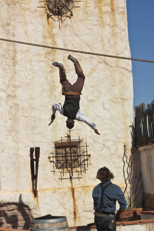 gunfighter: Tucson, Arizona - March 9: Old Tucson on March 9, 2015, in Tucson, Arizona. A pair of Old Tucson stuntmen dressed in period cowboy costume thrills tourists at historic Old Tucson  where gunfights and barroom brawls are staged in a celebration of the Old W