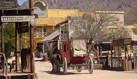 gunfights: Tucson, Arizona - March 9: Old Tucson on March 9, 2015, in Tucson, Arizona. An Old Tucson scene welcomes tourists to historic Old Tucson  where gunfights and barroom brawls are staged in a celebration of the Old West.