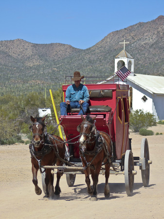 gunfights: Tucson, Arizona - March 9: Old Tucson on March 9, 2015, in Tucson, Arizona. An Old Tucson stagecoach ride transports tourists at historic Old Tucson  where gunfights and barroom brawls are staged in a celebration of the Old West.