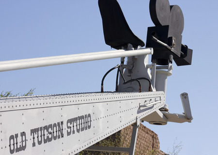 gunfights: Tucson, Arizona - March 9: Old Tucson on March 9, 2015, in Tucson, Arizona. An old filmmaking boom lift welcomes tourists to historic Old Tucson  where gunfights and barroom brawls are staged in a celebration of the Old West.
