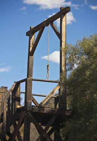 gallows: A Hangmans Noose Through a Rustic Wooden Window Frame